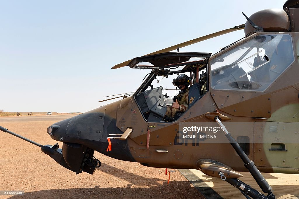 A French pilot of Barkhane counterterrorism operation in Africa's Sahel region is pictured in his Caiman war helicopter before the visit of France...