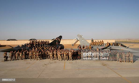 French pilots pose for a group photo at Kandahar air base in front of Rafale and Mirage combat aircraft France redeployed six fighter planes from...