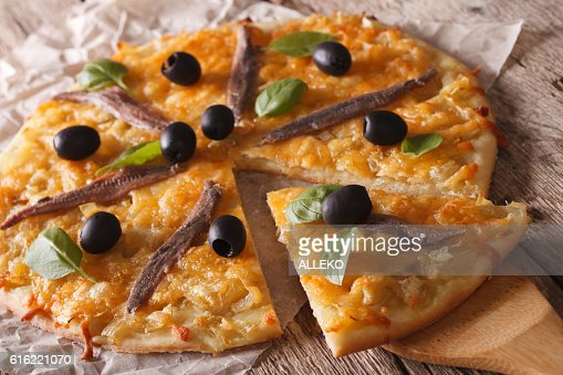 French Pissaladiere with anchovies and onions close-up. horizontal : Stock-Foto