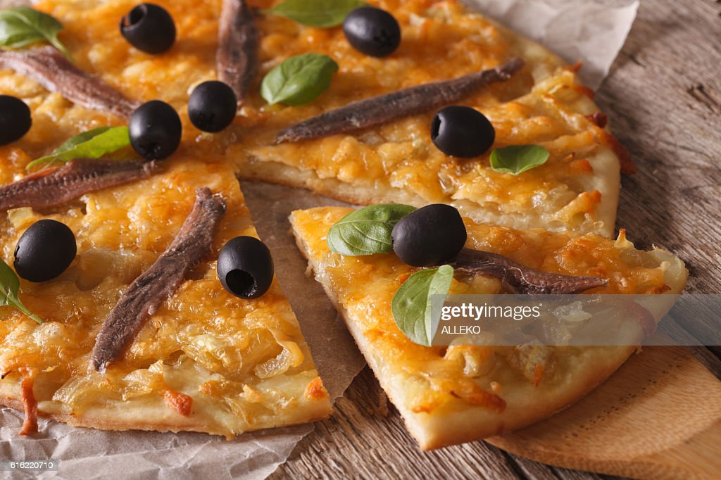 French pizza with anchovies and onions close-up. Horizontal : Stock Photo