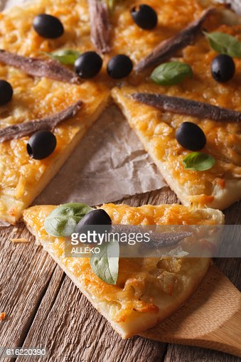 French pizza with anchovies and onions close-up. vertical : Stock Photo