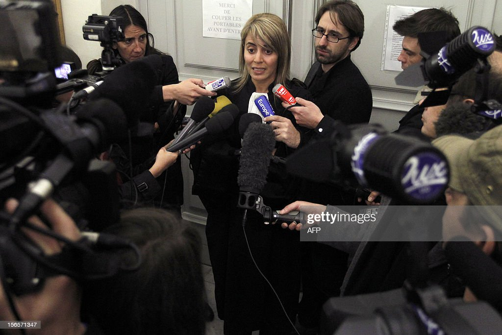 French plaintiff lawyer Aljia Fazai (C) speaks to journalists at the end of the trial of a 19-year-old boy who shot dead his parents and 10-year-old twin brothers in 2009, on November 17, 2012 at the courthouse in Ajaccio. The accused, named as Andy, exterminated the entire family in August 2009 with his father's Winchester rifle in an act he said occurred in a trance-like state. AFP PHOTO / PASCAL POCHARD-CASABIANCA