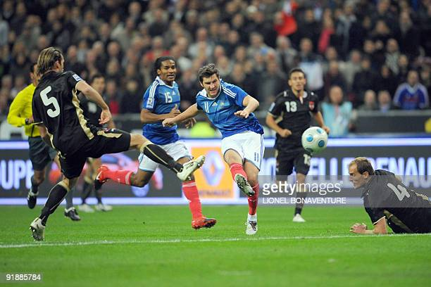 French player Andre Pierre Gignac shoots the ball to score during the World Cup 2010 qualifying football match France vs Austria on October 14 2009...