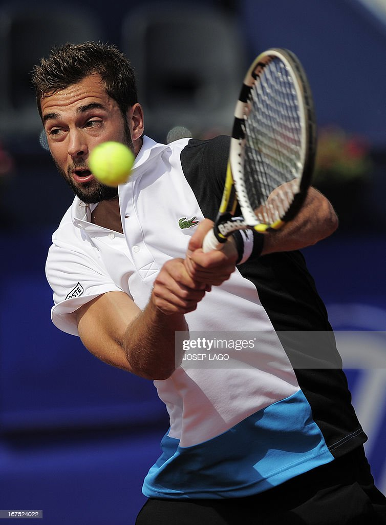 French player Benoit Paire returns the ball to Spanish player Rafael Nadal during the Barcelona Open tennis tournament Conde de Godo in Barcelona on April 26, 2013. Nadal won 6-7, 2-6.