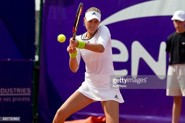 French player Kristina Mladenovic returns the ball to Alla Kudryatseva during their quarter final match at Strasbourg tennis open tournament in...