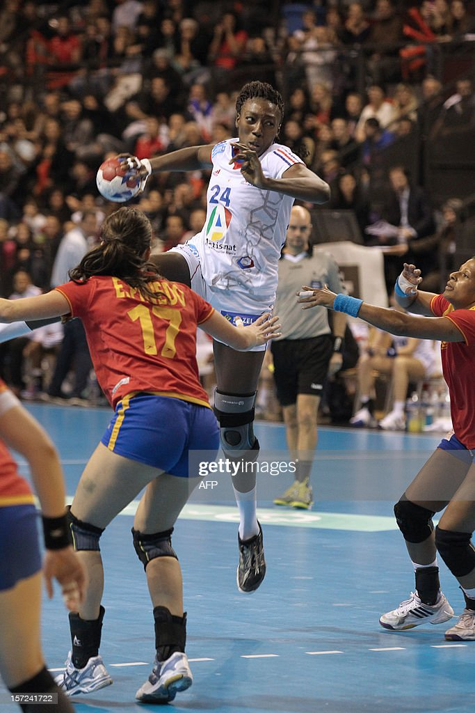 French player Mariama Signate (C) shots the friendly women's handball match France vs Spain, on November 30, 2012 at the Palais des victoires sports hall, in Cannes, southeastern France. AFP PHOTO / JEAN CHRISTOPHE MAGNENET