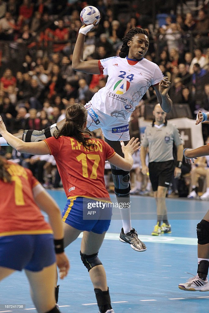 French player Mariama Signate (C) shots the friendly women's handball match France vs Spain, on November 30, 2012 at the Palais des victoires sports hall, in Cannes, southeastern France.