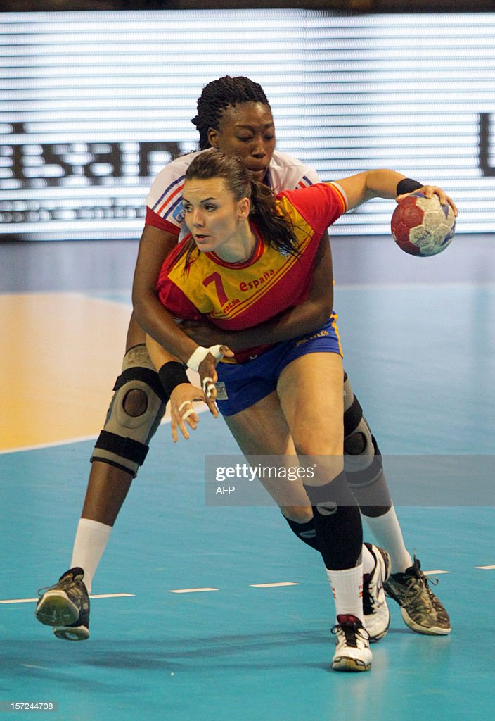French player Mariama Signate (back) vies with Spanish player Beatriz Fernandez (front) during the friendly women's handball match France vs Spain, on November 30, 2012 at the Palais des victoires sports hall, in Cannes, southeastern France. AFP PHOTO / JEAN CHRISTOPHE MAGNENET