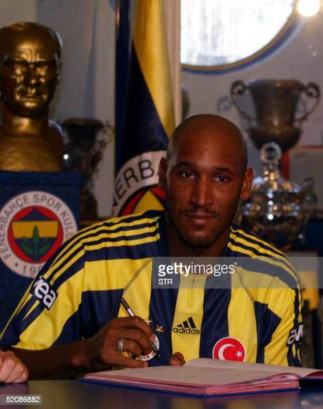 French player Nicolas Anelka wearing Fenerbahce's shirt signs his contract during the signing up ceremony at the club's headquaters in Istanbul 31...