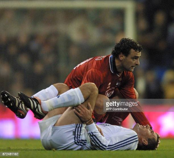 French player of Real Madrid Zinedine Zidane lies injured and is consolated by De Pedro of Real Sociedad during the first division soccer match in...