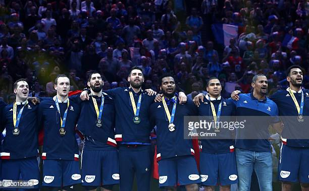 French players and coach Didier Dinart pose with their winners medals after victory during the 25th IHF Men's World Championship 2017 Final between...