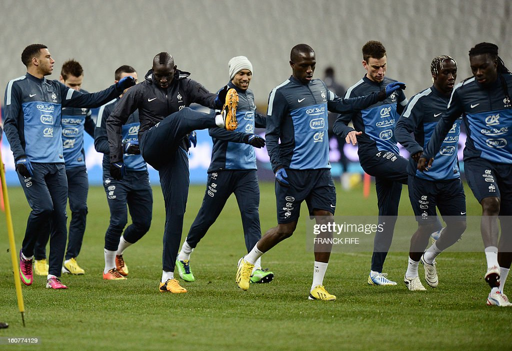 French players attend a training session on February 5, 2013 at the Stade de France in Saint-Denis, near Paris, on the eve of a friendly international football match between France and Germany. AFP PHOTO / FRANCK FIFE
