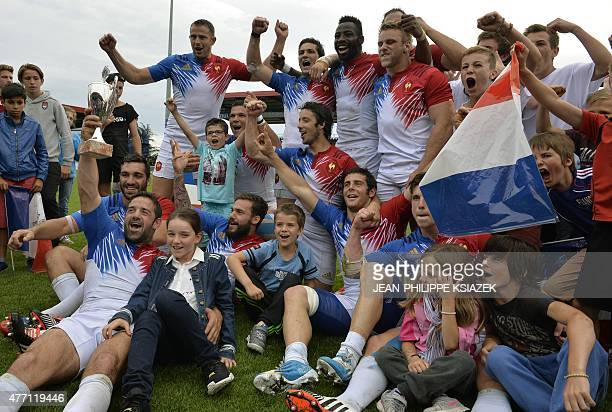 French players celebrate after winning the 2015 Seven's Grand Prix Series rugby tournament after the final match against Spain's team at the Matmut...
