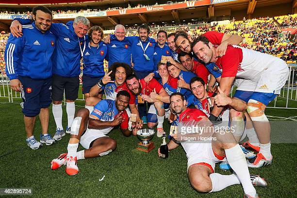 French players celebrate after winning the bowl final match between France and Argentina in the 2015 Wellington Sevens at Westpac Stadium on February...