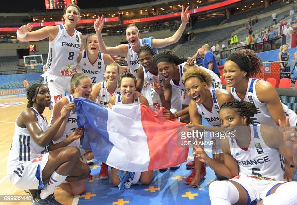 French players celebrate their victory after the FIBA EuroBasket 2017 women's quarterfinal match between France and Slovakia on June 22 2017 in...