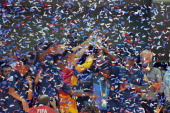 French players celebrate with their trophy after beating Uruguay at penalty kicks during their FIFA Under 20 World Cup final football match at Turk...