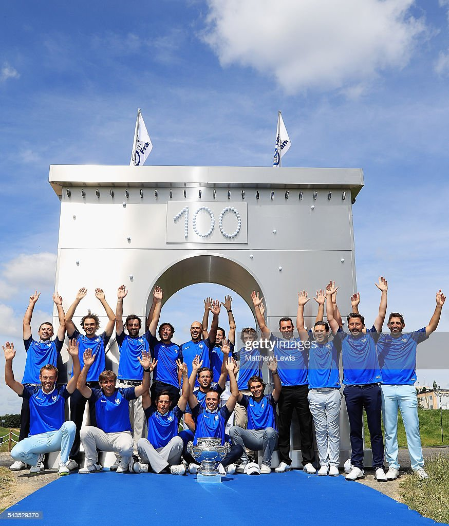 French players gather around the trophy ahead of the 100th Open de France at Le Golf National on June 29, 2016 in Paris, France.