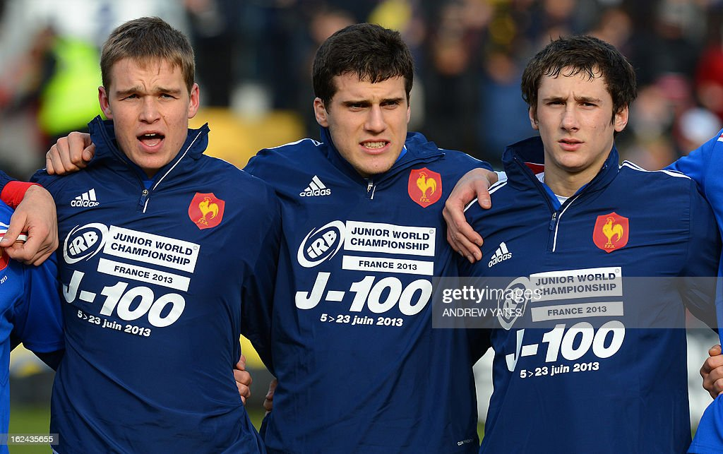 French players line up for the national anthem wearing jackets advertising the forthcoming junior world championships, before the Under 20 Six Nations International rugby union match between England U20s and France U20s at Sixways Stadium, Worcester, central England, on February 23, 2013. England under 20s won the game 40-10.