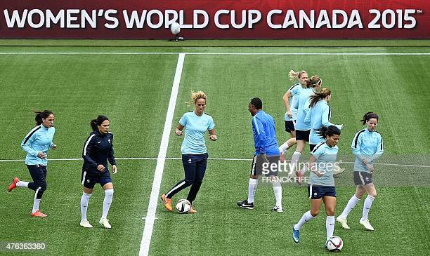 French players participate in a training session at the Moncton Stadium on June 8 2015 on the eve of France's 2015 FIFA Women's World Cup group F...