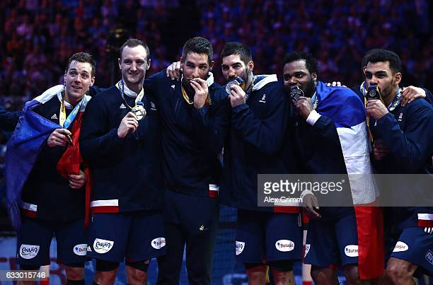 French players pose with their winners medals after victory during the 25th IHF Men's World Championship 2017 Final between France and Norway at...