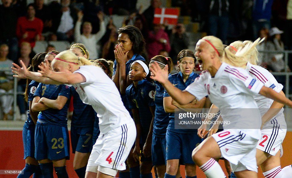 French players react as Denmark's celebrate their victory at the end of the penalty shootout of the the UEFA Women's European Championship Euro 2013 quarter final football match France vs Denmark on July 22, 2013 in Linkoping, Sweden. AFP PHOTO/JONATHAN NACKSTRAND
