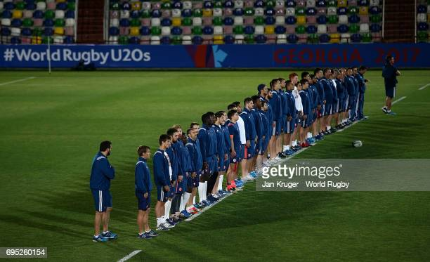 French players stand together on the ten yard line during the captain's run ahead of their match against New Zealand at Mikheil Meskhi Stadium on...