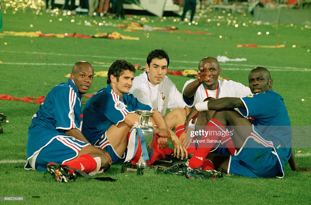 French players <a gi-track='captionPersonalityLinkClicked' href=/galleries/search?phrase=Sylvain+Wiltord&family=editorial&specificpeople=212988 ng-click='$event.stopPropagation()'>Sylvain Wiltord</a>, Bixente Lizarazu, <a gi-track='captionPersonalityLinkClicked' href=/galleries/search?phrase=Robert+Pires&family=editorial&specificpeople=167225 ng-click='$event.stopPropagation()'>Robert Pires</a>, Patrick Vieira and <a gi-track='captionPersonalityLinkClicked' href=/galleries/search?phrase=Lilian+Thuram&family=editorial&specificpeople=211248 ng-click='$event.stopPropagation()'>Lilian Thuram</a> remain on the field after their victory in the 2000 UEFA European Championship final, France vs Italy (2-1).