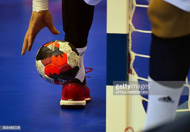 French players warm with ball prior to their match against Serbia on the Men's 2016 EHF European Handball Championships between Serbia and France in...