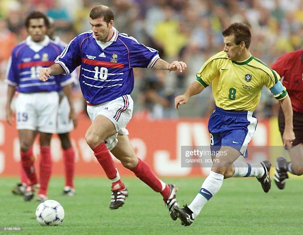 French playmaker Zinedine Zidane dribbles by Brazilian captain Dunga 12 July at the Stade de France in SaintDenis during he 1998 World Cup final...