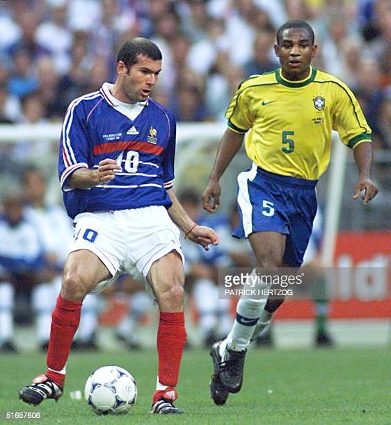 French playmaker Zinedine Zidane is challenged by Brazilian defender Cesar Sampaio 12 July at the Stade de France in SaintDenis during the 1998 World...