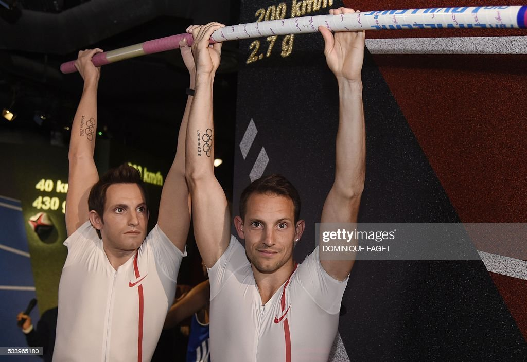 French pole vault champion Renaud Lavillenie poses next to his waxwork model at the Grevin Museum in Paris on May 24, 2016 during the official presentation of his effigy in Paris. / AFP / DOMINIQUE