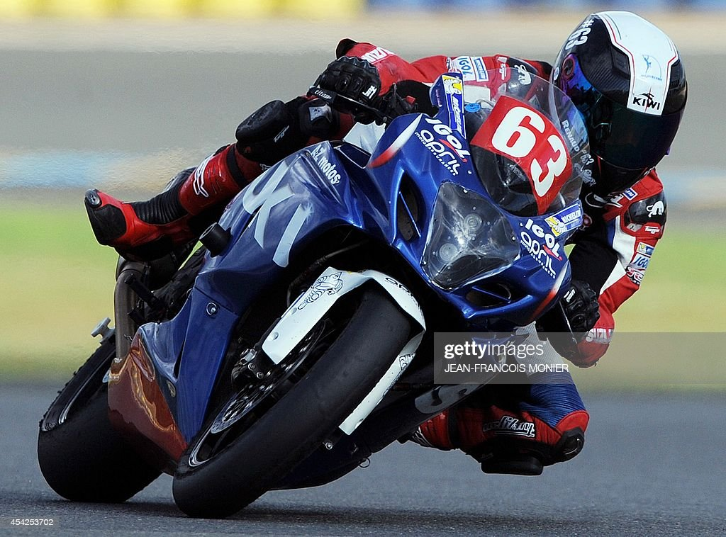 French pole vault world record holder Renaud Lavillenie rides his Suzuki GSXR motorcycle during a training practice session of the Le Mans 24-Hour endurance moto race on August 26, 2014, in Le Mans, western France. Lavillenie will take the start of the race on September 20, 2014.
