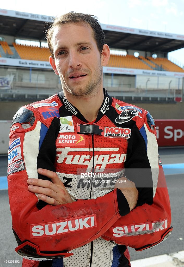 French pole vault world record holder Renaud Lavillenie waits during a training practice session of the Le Mans 24-Hour endurance moto race on August 26, 2014, in Le Mans, western France. Lavillenie will take the start of the race on a Suzuki GSXR on September 20, 2014.