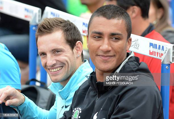 French pole vaulter Renaud Lavillenie and American decathlete and Olympic champion Ashton James Eaton attend on September 15 2013 the 37th edition of...