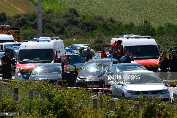 TOPSHOT French police and emergency workers intervene on the site after the police arrested a suspect on the A16 motorway near Marquise northern...
