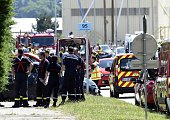French police and firefighters gather at the entrance of the Air Products company in SaintQuentinFallavier near Lyon central eastern France on June...