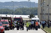French police and firefighters secure the entrance of the Air Products company in SaintQuentinFallavier near Lyon eastern France on June 26 2015 An...