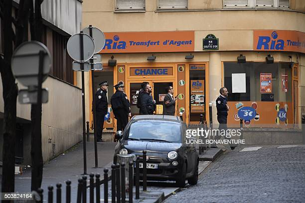 French police are seen near a police station in the Rue de la Goutte d'Or near BarbesRochechouart metro station in the north of Paris on January 7...