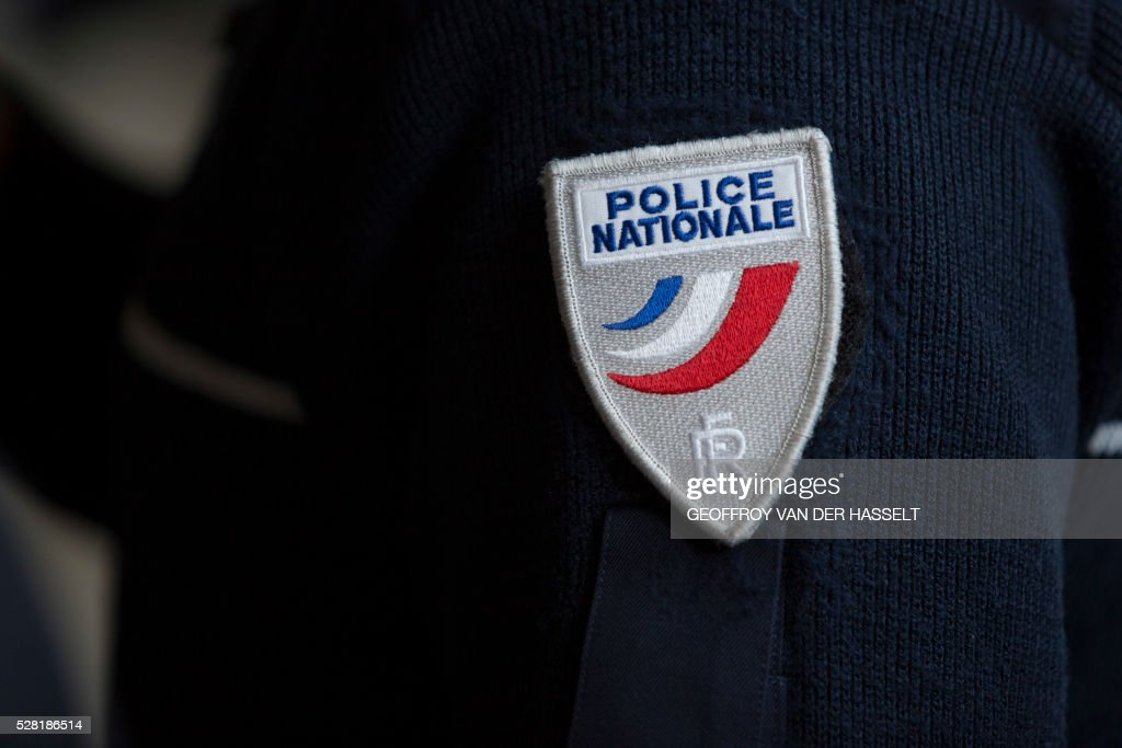 A French police (Police Nationale) badge is pictured during the presentation of the French police (Police Nationale) new recruitment campaign, on May 4, 2016 in Paris. / AFP / Geoffroy Van der Hasselt