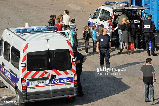French police carry out identity checks at a Roma camp on October 1 2013 in Roubaix northern France French Minister Manuel Valls has been publicly...