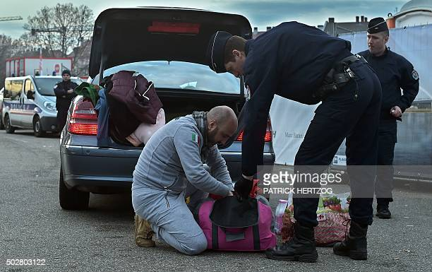 French police controls a car as they search for fireworks at the border between France and Germany in the eastern French city of Strasbourg on...