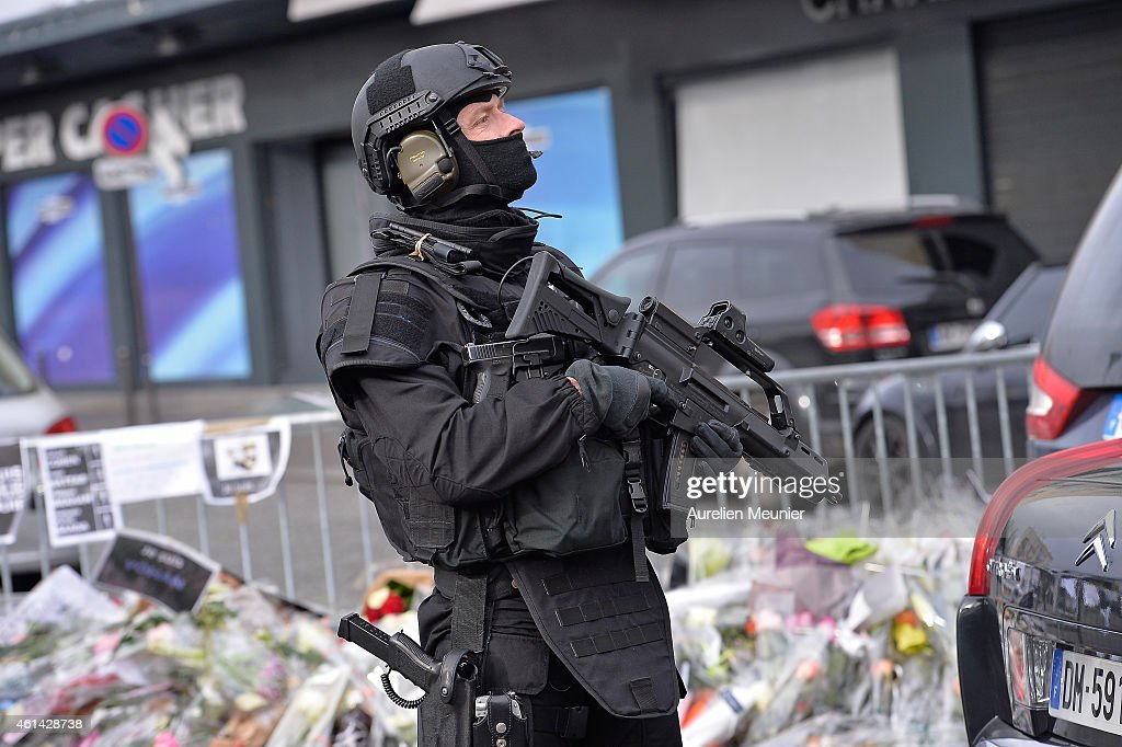 [Image: french-police-elite-raid-secures-the-are...d461428738]