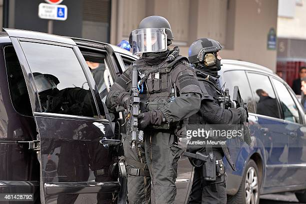 French police elite RAID secures the area while Benjamin Netanyahu Prime Minister of Israel pays his respects at the Hyper Cacher following the...