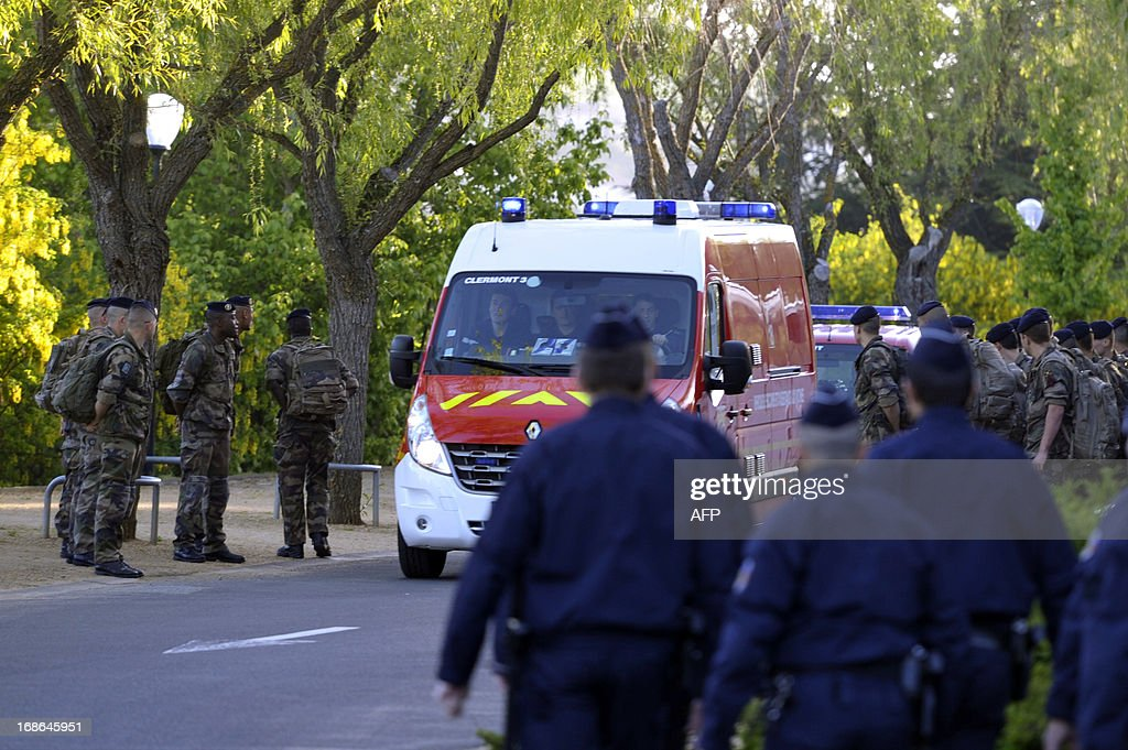 French police, firemen and soldiers take part in a search on May 13, 2013 in a park of the Central France city of Clermont-Ferrand where Fiona, a five-year-old girl went missing the day before while having a walk with her mother and another two-year-old kid. AFP PHOTO / RICHARD BRUNEL