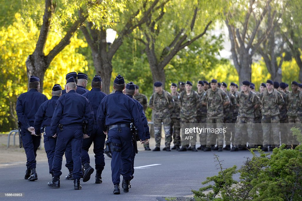 French police, firemen and soldiers take part in a search on May 13, 2013 in a park of the Central France city of Clermont-Ferrand where Fiona, a five-year-old girl went missing the day before while having a walk with her mother and another two-year-old kid.