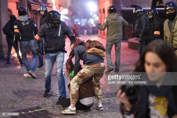 French police forces detain antifascist demonstrators during clashes in Nantes western France on April 23 2017 following the announcement of the...