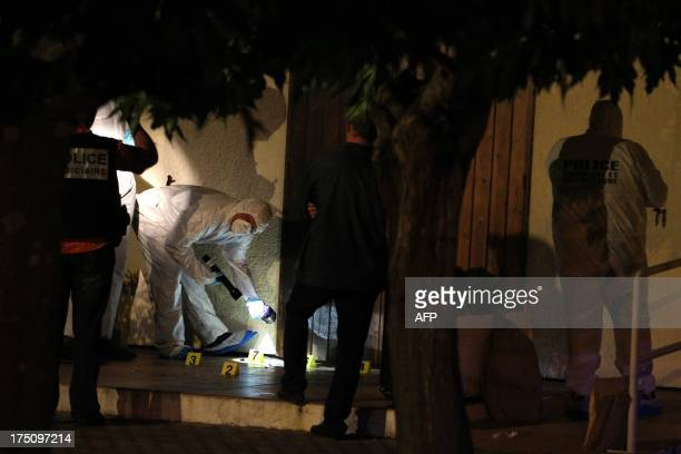 French police forensics expert work on a Jehovah religious center which has been damaged by a blast on August 1 in Ajaccio French Mediterranean...