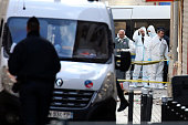 French Police Forensics officers work on Rue des Corbillon in the northern Paris suburb of SaintDenis following a raid on an apartment on November 18...