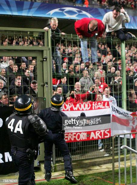 French police hold back Manchester United fans in the away section during the UEFA Champions League Round 16 first leg match between Lille OSC and...