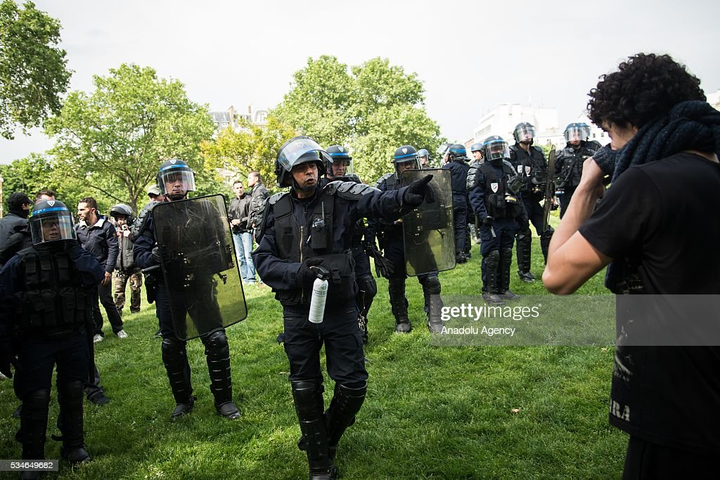 French police interferes to the protestors during the protest against French government's labor law reform in Paris, France on May 26, 2016.